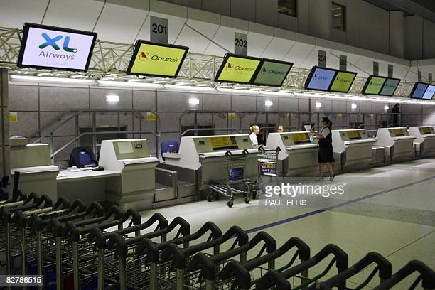 Check-in counters for Britain's third largest tour operator, XL Leisure Group, which operates XL Airways, are empty at Manchester Airport in...