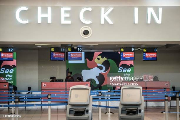 Checkin desks remain unmanned at Kenya Airways during a strike by airline workers at the Jomo Kenyatta International Airport in Nairobi on March 6...