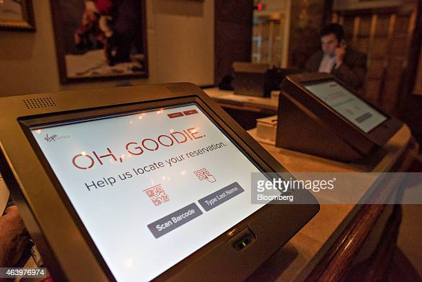 Checkin kiosks await guests in the lobby of the Virgin Hotels Chicago in Chicago Illinois US on Friday Feb 20 2015 The 250room hotel in Chicago's...