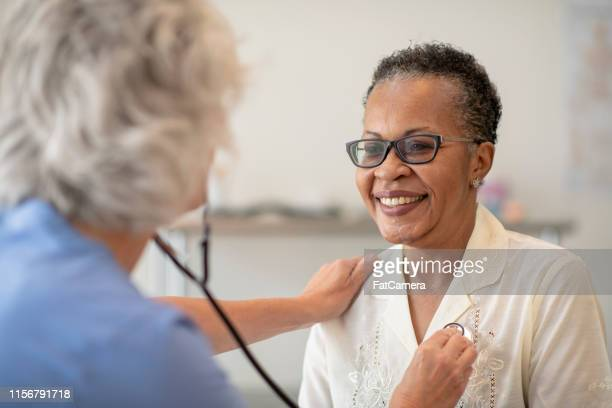 checking a heart beat - heart health stock pictures, royalty-free photos & images