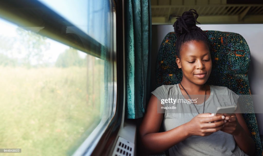 Checking apps for travelling updates : Stock Photo