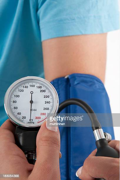 checking blood pressure close
