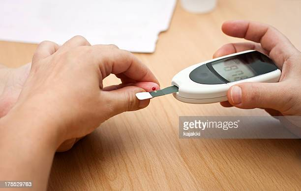 checking blood-sugar levels - glucose stock pictures, royalty-free photos & images