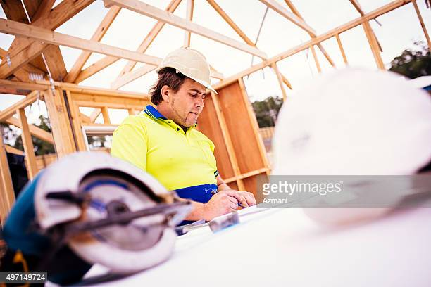 Checking Blueprints on Construction Site
