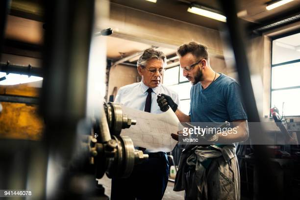 checking blueprints - mechanical engineering stock pictures, royalty-free photos & images