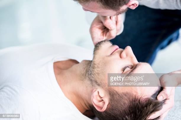 checking breathing - unconscious stock pictures, royalty-free photos & images