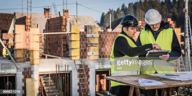 checking construction plan details - rebuilding stock pictures, royalty-free photos & images
