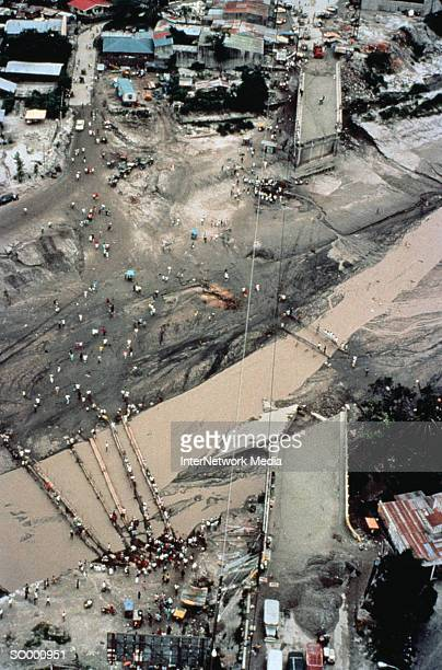 checking damage to bridge - mt pinatubo stock photos and pictures