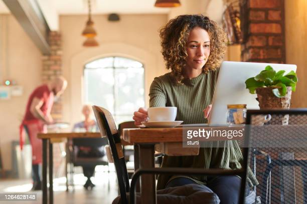 checking emails  at the coffee shop - internet cafe stock pictures, royalty-free photos & images