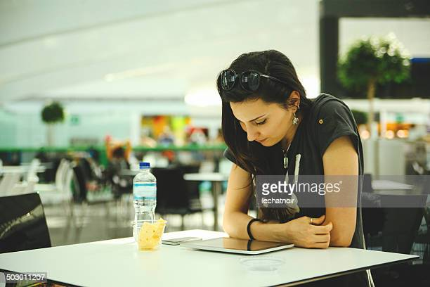 checking e-mails in airport cafe