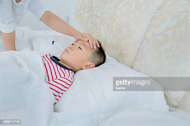 checking fever - hot nurse stock photos and pictures