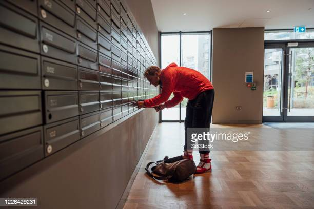 checking for mail - one mid adult man only stock pictures, royalty-free photos & images