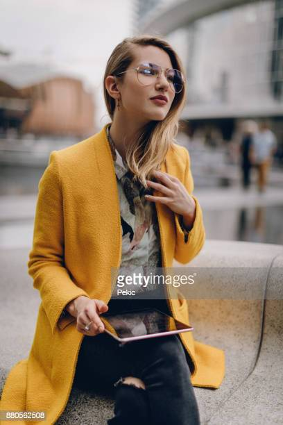 checking for wifi networks - yellow coat stock pictures, royalty-free photos & images