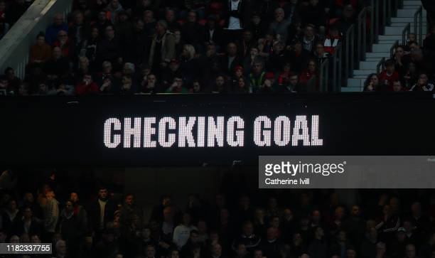 VAR checking goal sign on the screen during the Premier League match between Manchester United and Liverpool FC at Old Trafford on October 20 2019 in...