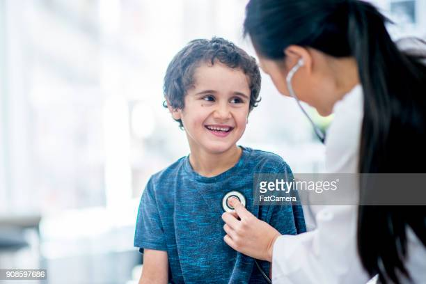 checking heart rate - paediatrician stock pictures, royalty-free photos & images
