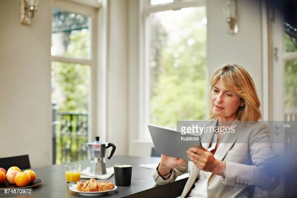 Checking her e-mail before starting the work day