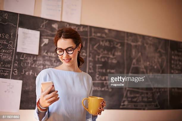 checking her emails before class - instructor stock pictures, royalty-free photos & images