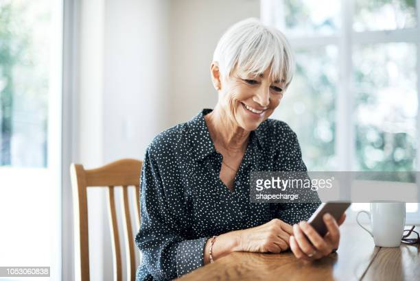 checking her messages - condition stock pictures, royalty-free photos & images