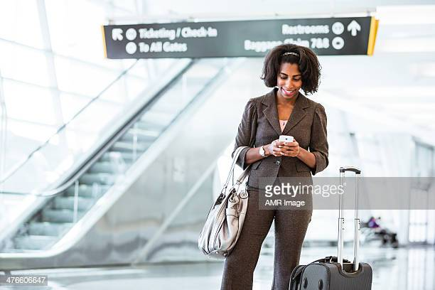 Checking her phone before heading out for an international conference