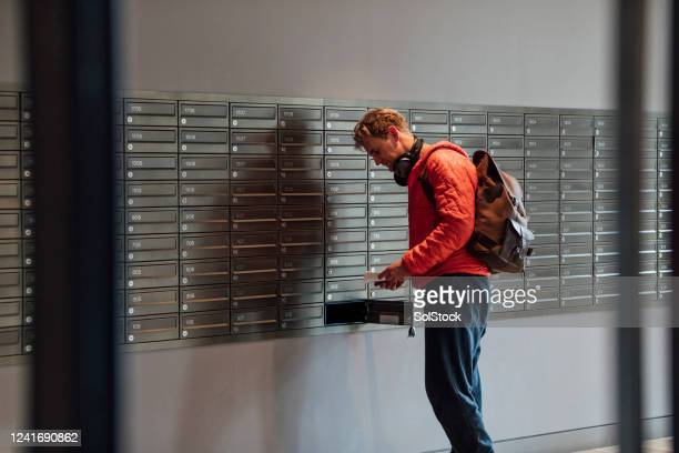 checking his mail - open backpack stock pictures, royalty-free photos & images