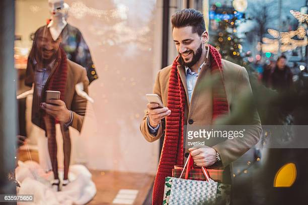 checking his shopping list - christmas shopping stock photos and pictures