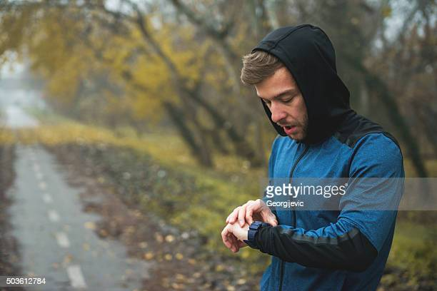Checking his watch