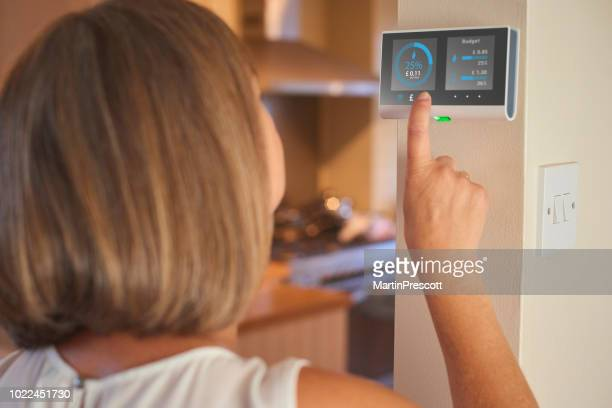 checking home energy consumption - smart stock pictures, royalty-free photos & images