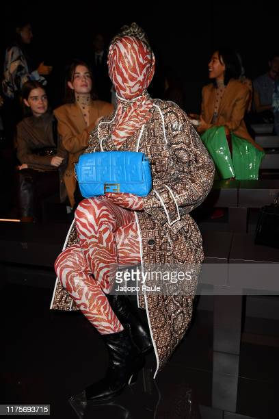 Checking Invoices attends the Fendi fashion show during the Milan Fashion Week Spring/Summer 2020 on September 19 2019 in Milan Italy