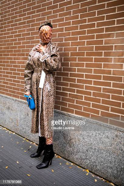 Checking Invoices poses outside the Fendi show during Milan Fashion Week Spring/Summer 2020 on September 19 2019 in Milan Italy