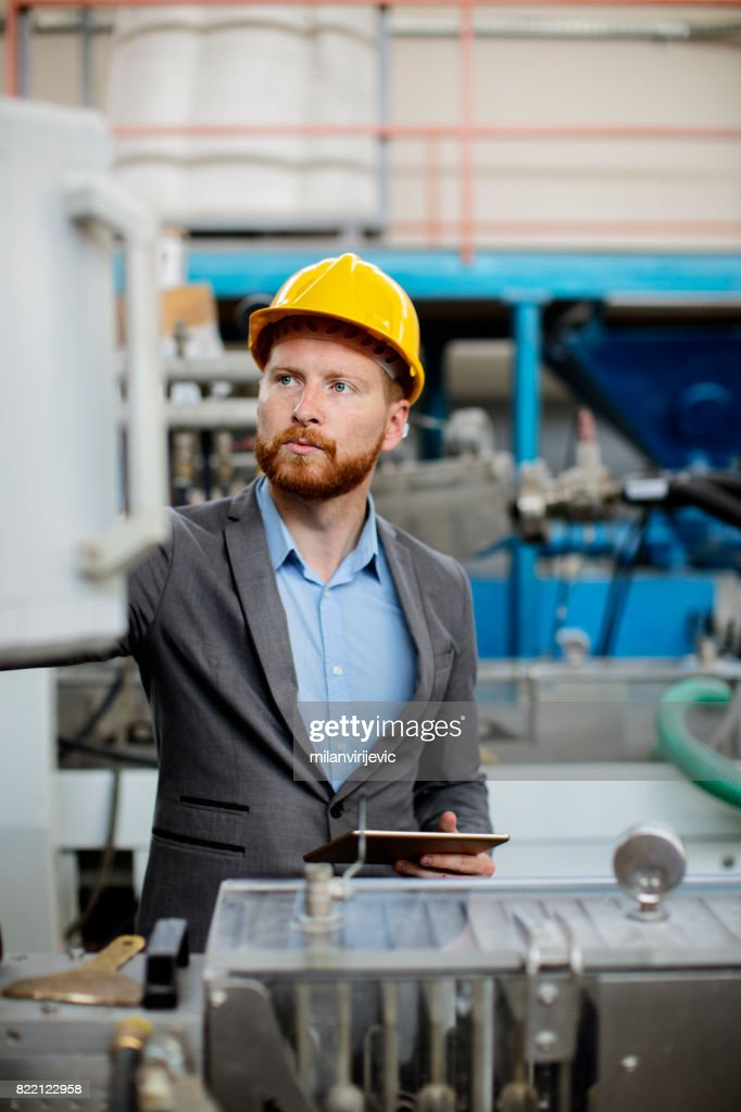 Checking machines in factory : Stock Photo