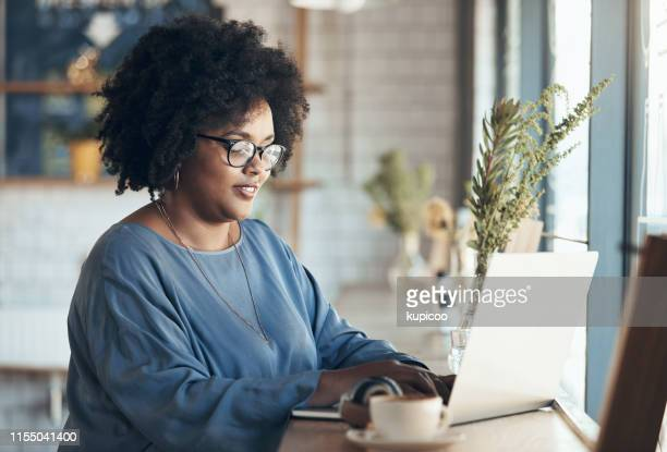 checking my emails - african ethnicity stock pictures, royalty-free photos & images