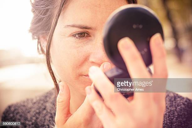 checking my look in powder compact mirror - powder compact stock pictures, royalty-free photos & images