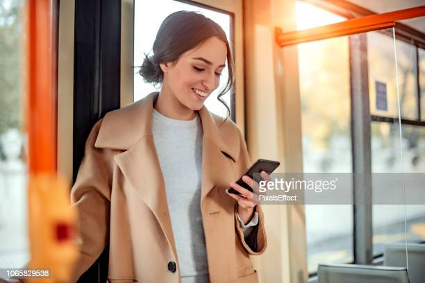 checking my transit app - rush hour stock pictures, royalty-free photos & images
