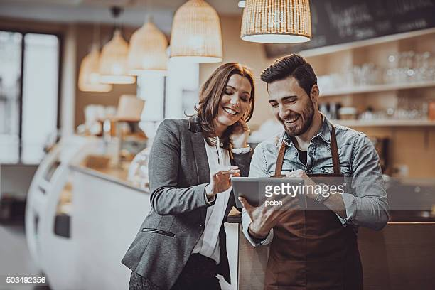 checking new  menu - restaurant stock photos and pictures