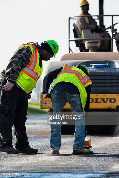 qc checking of newly laid asphalt on highway - cmannphoto stock pictures, royalty-free photos & images
