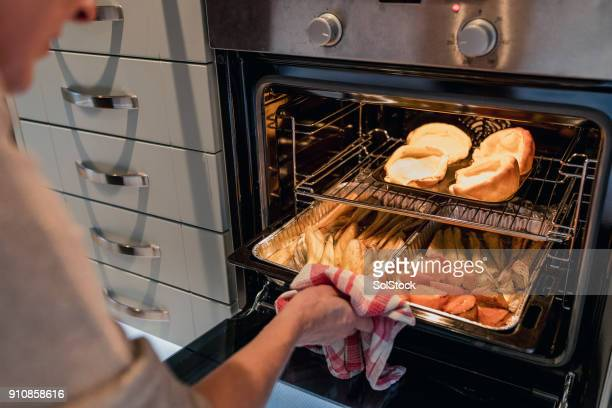 checking on christmas dinner - hot older women stock pictures, royalty-free photos & images