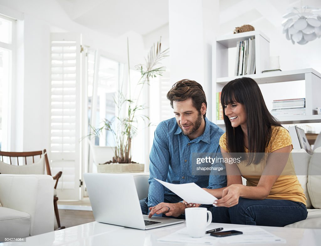 Checking on their investments : Stock Photo