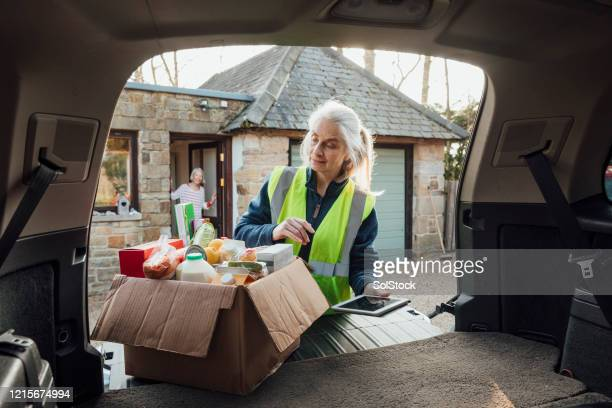 checking over the groceries - social distancing stock pictures, royalty-free photos & images