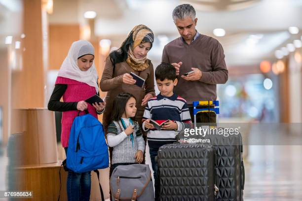 checking passports - family politics stock pictures, royalty-free photos & images
