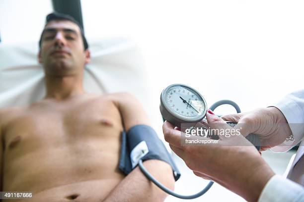 Checking the blood pressure at the medical exam