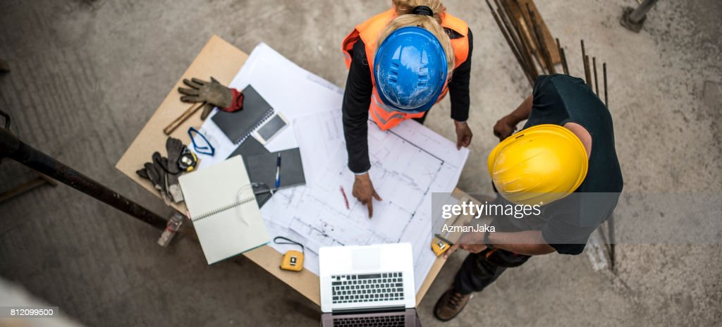 Checking the blueprints : Stock Photo