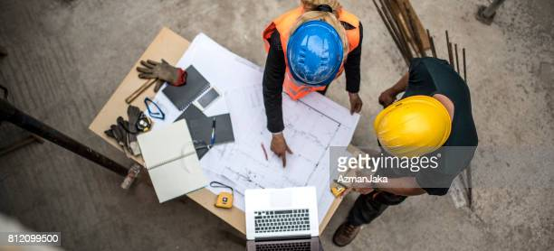 checking the blueprints - building contractor stock pictures, royalty-free photos & images