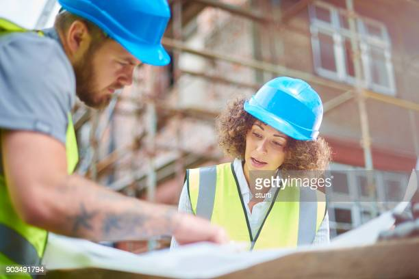 checking the blueprints - civil engineering stock photos and pictures
