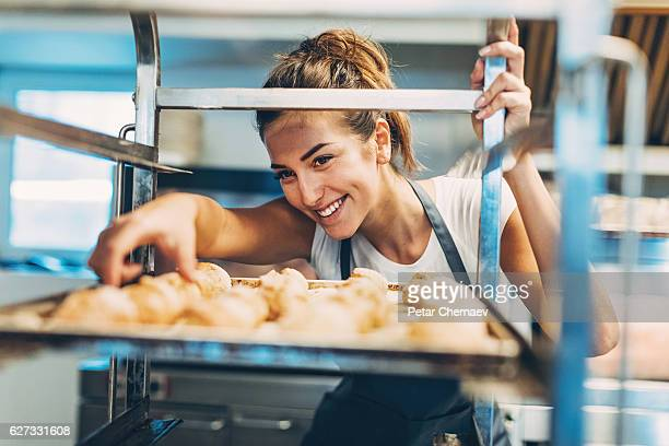 Checking the freshly baked croissants