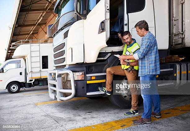checking the manifest one last time - transportation stock pictures, royalty-free photos & images