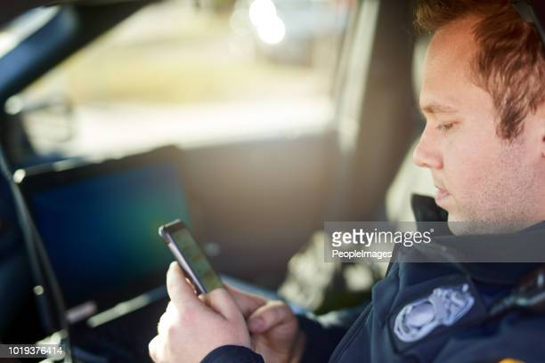 checking the news - police force stock pictures, royalty-free photos & images