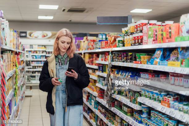 checking the shopping list - cultures stock pictures, royalty-free photos & images