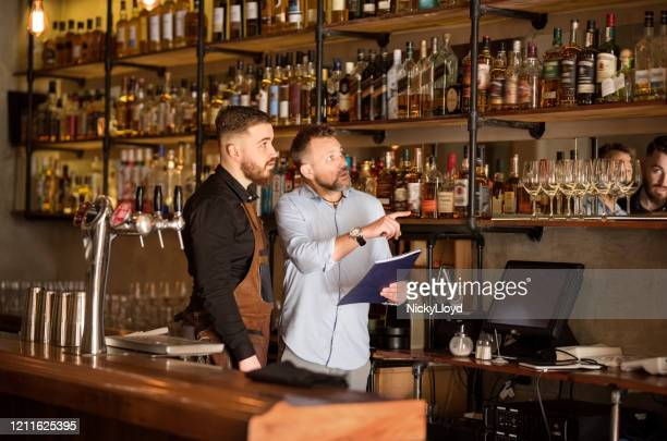 checking the stock in the bar - bar drink establishment stock pictures, royalty-free photos & images