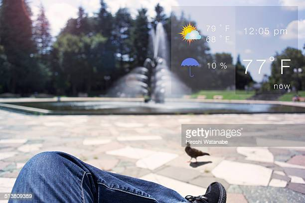Checking the weather to sit on a bench in the park