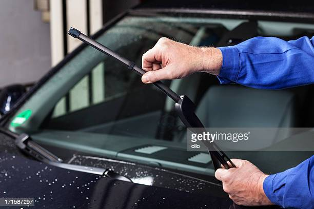 checking the windscreen wiper - windshield stock pictures, royalty-free photos & images